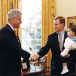 "iUniverse author Dan Emmett with his son , ""Within Arms Length"", greets President Bill Clinton in the Oval Office"